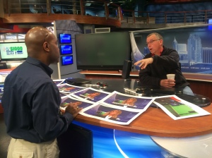 WRAL Director James Ford and Lead Designer Steve Loyd work on presentation